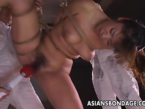 Kinky Asian in bondage receives a nasty dildo
