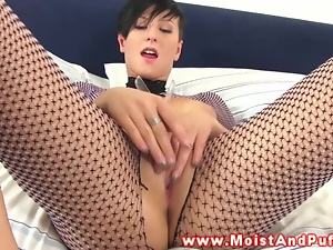 Puffy babe sticks objects in her moist pussy
