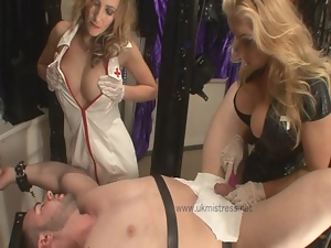 Dude is overwhelmed by two dominating babes
