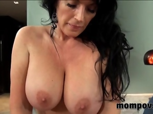 MILF with ample tits ruts on a big dick