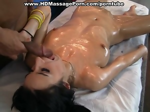 Titted brunette fucked on a massage