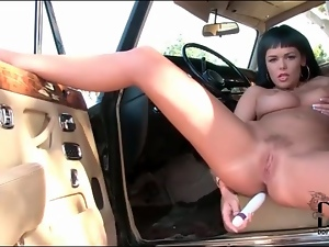 Curvy girl anally masturbates on the car