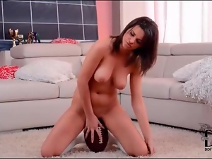 Curvy girl sits her hot pussy on a football