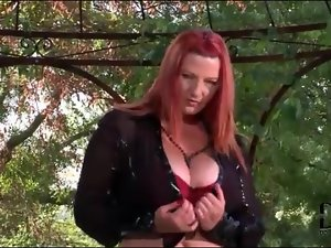 Curvy redhead in a slutty latex skirt
