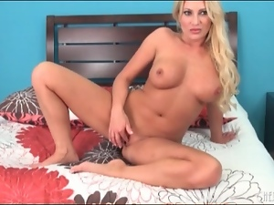 Nude and tanned blonde fucks dildo