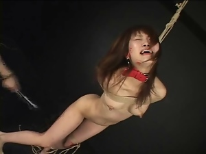 Japanese girl in pain from flogging