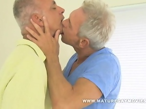 Two sexy silverdaddies barebacking in a hotel room
