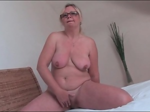 Mature blonde with hairy bush masturbates