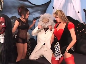 Two costume girls suck his dick lustily