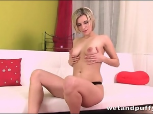 Blonde with great tits fingers her bald pussy