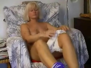 Solo mature pleasures her bald pussy
