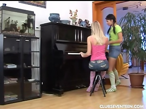 Sexy lesbians toy muffs on piano