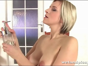 Blonde pees her panties and plays with them