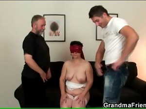 Blindfolded mature sucks two hard dicks