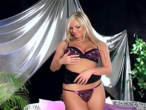 Busty blonde in a bra panties and black stockings