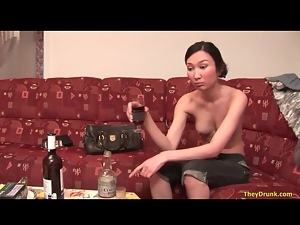 Asian girl doing shots and drinking wine