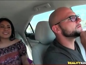 Latin girl flashes tits and pussy in the car