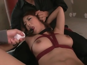Bound Japanese girl toyed on her hairy pussy