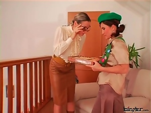 Girl selling cookies to a sexy blouse mistress