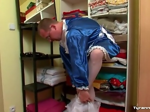 Guy puts on a blue satin French maid dress
