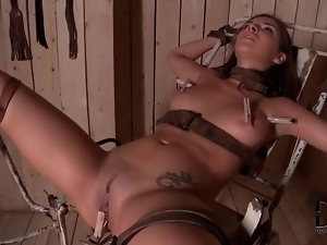 Bound girl flogged on the ass and toy fucked