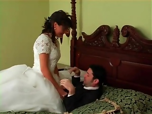 Two angry brides in dresses have a catfight