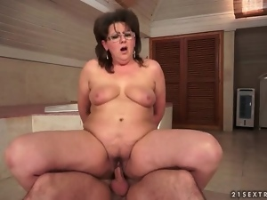 Curvy mature in glasses rides dick in bathroom