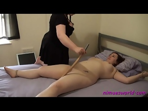 Mistress plays with her tied down fat girl