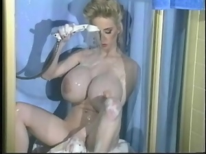 She has giant fake boobs and she washes them for you