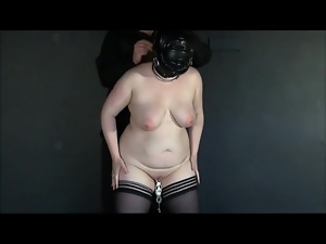 Leather hood on fat girl in his dungeon