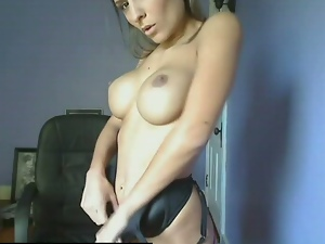 Busty webcam slut provokes with her fake tits