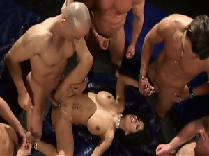 Gorgeous brunette gets gangbanged by horny studs