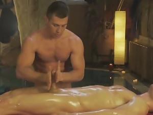 Horny dude enjoys a sensual gay oil massage.
