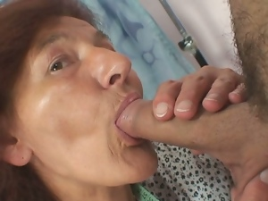 Redheaded granny slammed by a young customer
