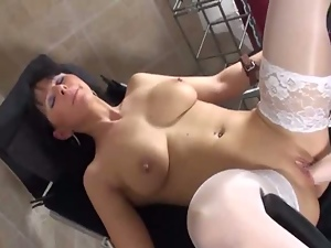 Milf in white stockings has her vagina fisted