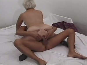 Horny granny loves it in the ass