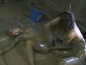 Naughty asians wrestling in the mud