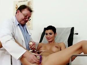 Wet pussy stretched during check-up