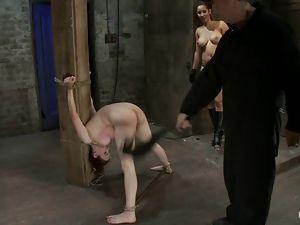 Horny slave gets tied up on the bar and that mistress gives her pleasures