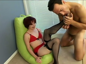 Petite Anna Belle Lee gives a footjob and blows a dick