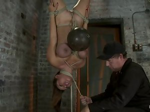 Busty Asian sex slave gets suspended upside down