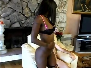 Slim Chocolate licks balls and sucks a dick in interracial video
