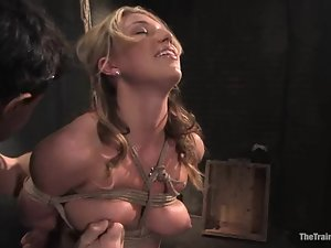 Blonde hottie gets bound and enjoys a big dildo in her smooth pussy