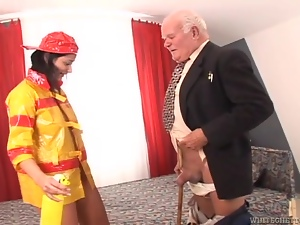 Brunette chick in firefighter uniform gets fucked by old man