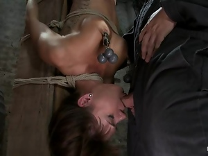 Gia Dimarco is tied up on the bar upside down