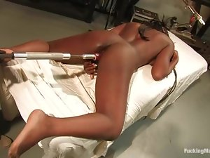 Juicy ebony gets her tits twitched on a fucking machine