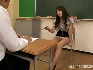 Sizzling Japanese teacher rides her student's dick