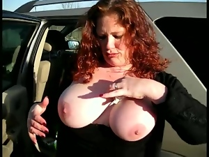 Busty Redhead Sucks a Big Shaft Out Of a Gloryhole in Public