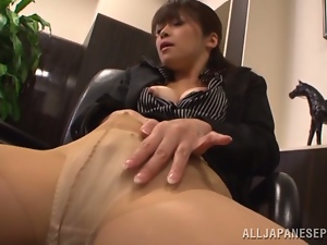 Japanese cutie Maki Hokujo plays with her pussy in an office