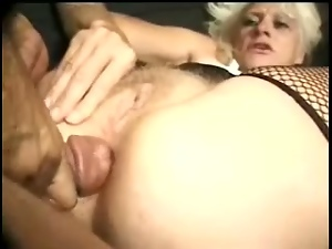Blonde granny Kathy Jones can't take her mouth off this tasty cock